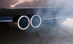 Car exhaust pipe expelling smoke